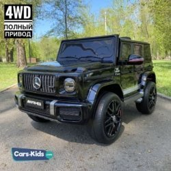 Электромобиль Mercedes-Benz AMG G63 K999KK 4WD черный (колеса резина, кресло кожа, пульт, музыка)